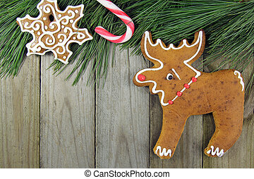 christmas background- fir tree, cane, gingerbread over wooden ta