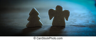 gingerbread figures Christmas tree and an angel on the wooden