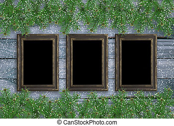 Christmas background in vintage style with three photo frames and spruce branches on wooden planks