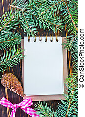 christmas background - note and brunch of christmas tree on ...
