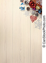 Christmas background on wooden table with copyspace. Top view of xmas tree pine cone and snowflake. fir branch silver balls.