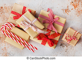 christmas background - box for present and candy cane on a...