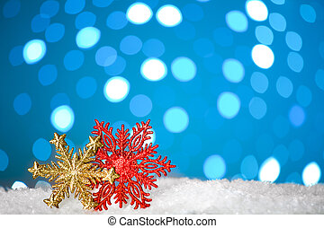Christmas background with a decorative snowflakes on snow