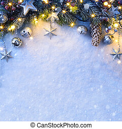 Christmas background with a silver ornament, christmas stars, berries and fir in snow