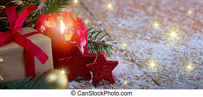 Christmas background with Advent candle and gift.