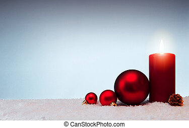 Christmas background with Advent candle and red bauble isolated on white snow.