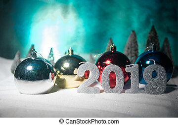Christmas background with baubles, on snow, free space for text. Christmas decoration.