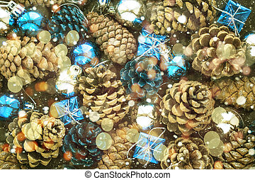 Christmas background with blue silver balls and pinecone.