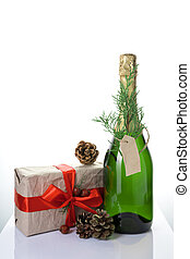 Christmas background with champagne, gift and cones on a light background.