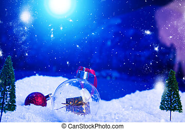 Christmas background with Christmas balls on snow over fir-tree, night sky and moon. Shallow depth of field. Christmas background. Fairy tale. Macro. Artificial magic dreamy world