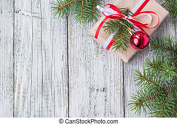 Christmas background with decorations and gift boxes on white wooden board
