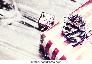 Christmas background with decorations and gift boxes on wooden board close up with copy space. Merry Christmas Card
