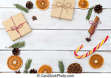 Christmas background with decorations and gift boxes on wooden board. Copy space