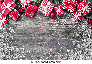 Christmas background with decorations and gift boxes on...