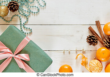 Christmas background with decorations and green gift boxes on white wooden table