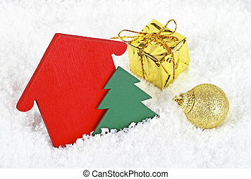 Christmas background with decorations, christmas tree, gift box and golden ball in snow