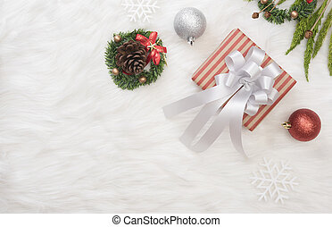 Christmas background with decorations gift box on white table.