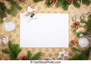 Christmas background with decorations on craft paper in rustic style.