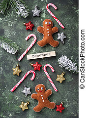 Christmas background with felt gingerbread men