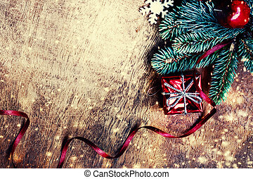 Christmas background with festive decoration on dark wooden board. Flat lay, Top view. Xmas Greeting Card