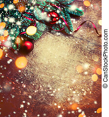Christmas background with festive decoration, pine tree branch, snowflakes and bokeh lights on dark wooden board. Merry Christmas and Happy New Year Concept. Copy space. Flat lay.