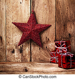 Christmas background with festive decorations on old wooden wall