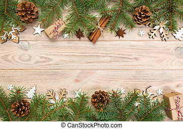 Christmas background with fir tree and gift box on wooden table. Top view with copy space for your design