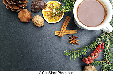 Christmas background with fir tree, nuts and hot chocolate