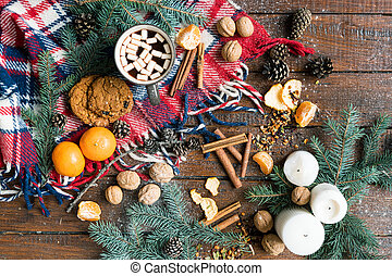 Christmas background with food, other objects and symbols on wooden table