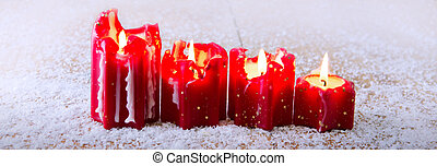 Christmas background with four Advent candles and snow.