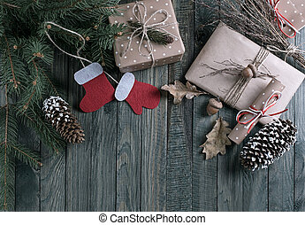 Christmas background with gift box, Santa Claus boots and scroll in vintage style on wooden boards