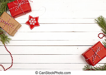 Christmas background with gift boxes and decorations on white wooden table. Space for text.