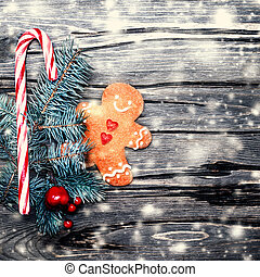 Christmas background with gingerbread cookie,creative  holiday decorations and snow, copy space