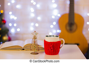 Christmas background with guitar. Still life in the home interior