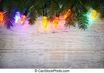 Christmas background with lights on branches - Multicolored...