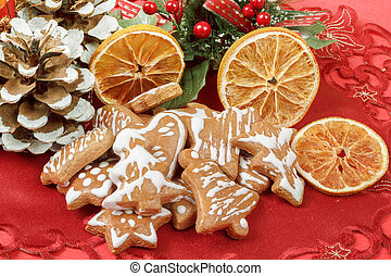 christmas background with needles. orange slices and gingerbreads