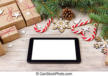 Christmas background with notebook, gift box, fir tree and holiday decorations on white table from above