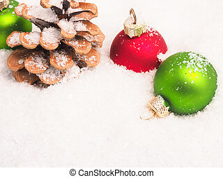 Christmas background with old baubles and pinecone
