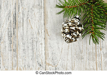 Christmas background with ornaments on branch