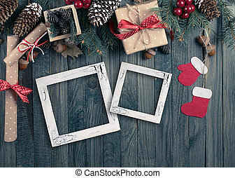Christmas background with photo frame, spruce, gift box, Santa Claus boots and scroll in vintage style