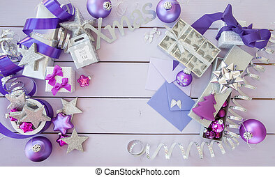 Christmas background with purple xmas ornaments and baubles