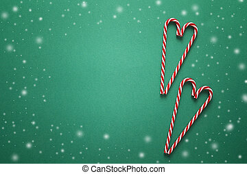 Christmas background with red candy canes in the shape of...