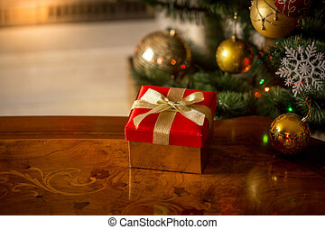 Christmas background with red gift box on wooden table in ...