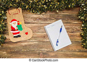 christmas background with santa and notebook