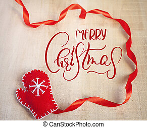 Santa Claus red mitten and text Merry Christmas. Calligraphy lettering