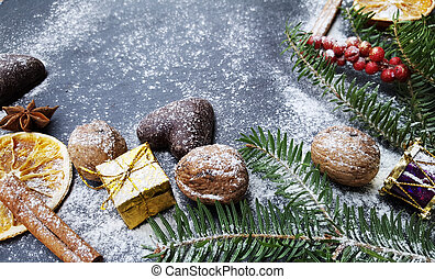 Christmas background with snow fir tree, nuts and gingerbreads
