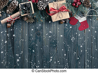 Christmas background with snow, spruce, gift box, Santa boots and scroll in vintage style on wooden shabby boards