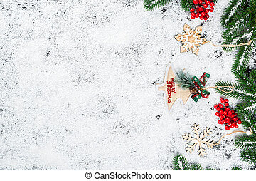 Christmas background with snowflakes, white snow, toys, candy, Christmas tree branches and New Year decor. Winter Holiday Frame