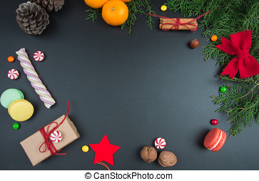 Christmas background with sweets on black chalkboard
