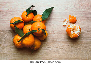 Christmas background with tangerines, on the table. Winter holiday frame. Flat lay top view